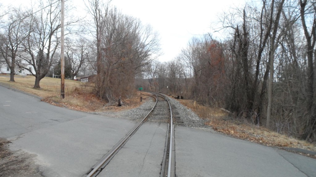 Looking northeast at the North Whitney Street train crossing in Amherst, Massachusetts